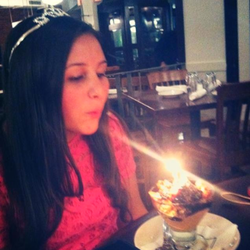 Photo of me blowing out a birthday candle