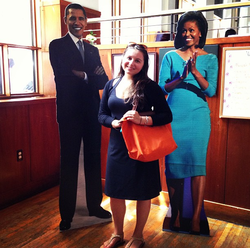 Photograph of me with large cutout figures of Barack and Michelle Obama